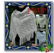 ◆ウール混のタム糸を使って編み上げたフリンジ付ポンチョ。◆